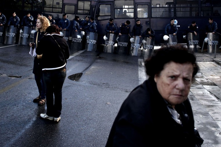 Greek riot police block on November 7, 2013 the headquarters of former public broadcaster ERT in Athens. Greek riot police burst into the headquarters of former public broadcaster ERT early on November 7 and forcibly removed employees who had been occupying the site since its shock shutdown five months ago. (Angelos Tzortzinis/AFP/Getty Images)
