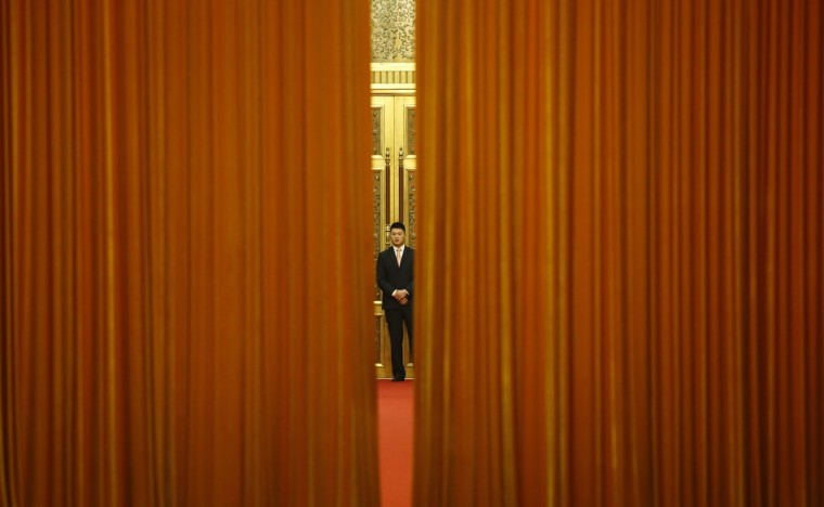 A security guard stands in front of a room where Brazil's Vice President Michel Temer and China's President Xi Jinping met at the Great Hall of the People in Beijing on November 7, 2013. (Kim Kyung-Hoon/AFP/Getty Images)