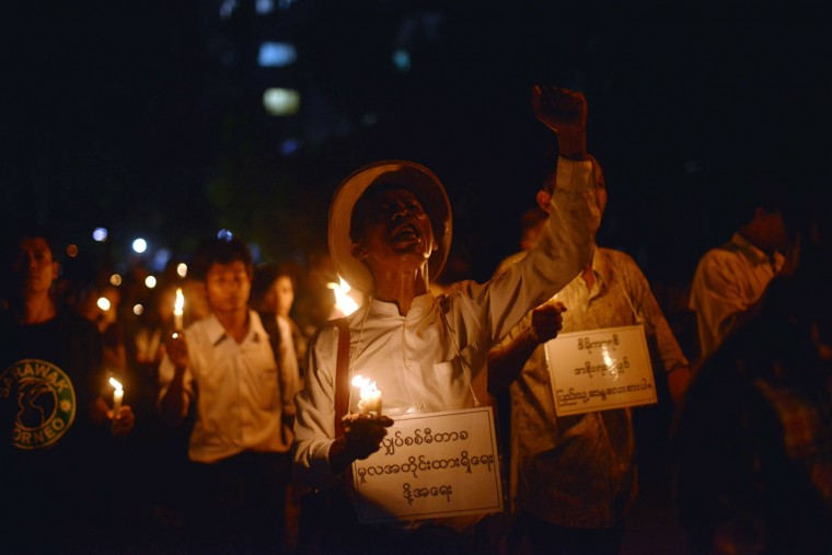 Myanmar protesters hold candles and shout slogans as they stage a protest against recent electricity price increases in Yangon on November 7, 2013. (Ye Aung Thu/AFP/Getty Images)