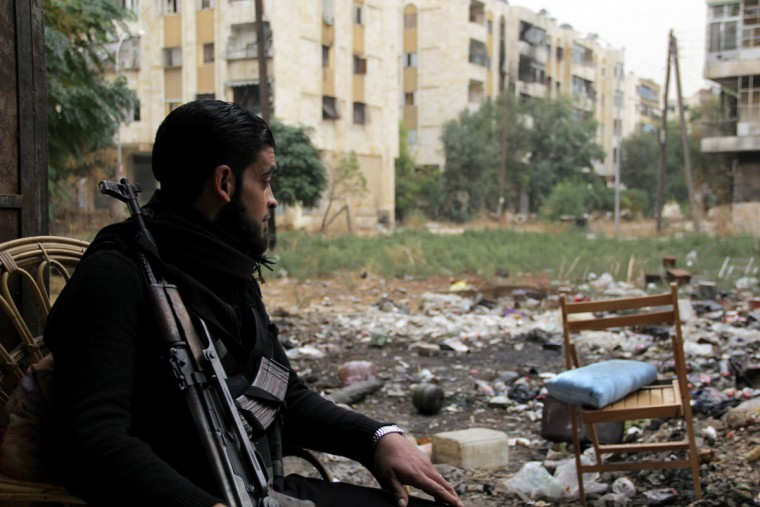 A rebel fighter is pictured on November 7, 2013, in the northern city of Aleppo. The Syrian conflict has killed more than 120,000 people since it broke out in March 2011, according to the Syrian Observatory for Human Rights. Karam Al-Maskrikaram/AFP/Getty Images)