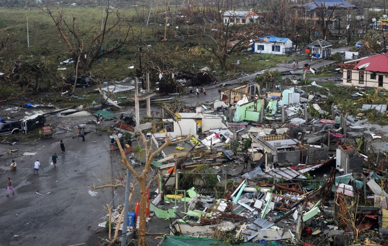 A general shot shows houses destroyed by the strong winds caused by typhoon Haiyan at Tacloban, eastern island of Leyte on November 9, 2013. More than 100 bodies were lying in the streets of a Philippine city smashed by Super Typhoon Haiyan, authorities said, as soldiers raced to reach many other devastated communities. Haiyan tore into the eastern islands of Leyte and Samar on Friday with sustained winds of around 315 kilometres (195 miles) an hour, making it the strongest typhoon in the world this year and one of the most intense ever to make landfall. (Noel Celis/AFP/Getty Images)
