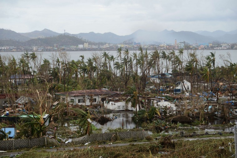 A general shot shows fallen trees and destroyed houses in the aftermath of Super Typhoon Haiyan in Tacloban, eastern island of Leyte on November 9, 2013. One of the strongest typhoons on record killed more than 100 people as savage winds and giant waves flattened communities across the Philippines, authorities said on November 9 while corpses lay amid the devastation. (Noel Celis/AFP/Getty Images)