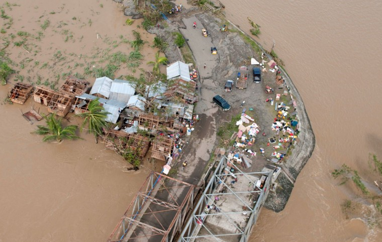 An aerial shot shows a flooded area in the aftermath of Supper Typhoon Haiyan that smashed into coastal communities on the central Philippines in Iloilo on November 9, 2013. A super typhoon likely killed hundreds of people in and around one Philippine town, a government minister who toured the area said on November 9. (Raul Banias/AFP/Getty Images)