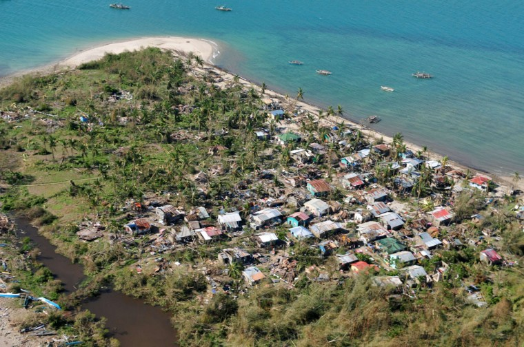An aerial shot shows devastation in the aftermath in the aftermath of Supper Typhoon Haiyan that smashed into coastal communities on the central Philippines in Iloilo on November 9, 2013. A super typhoon likely killed hundreds of people in and around one Philippine town, a government minister who toured the area said on November 9. (Raul Banias/AFP/Getty Images)