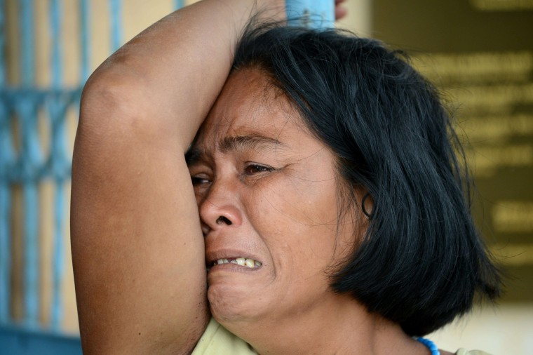 A woman mournes her dead son at a chapel in the aftermath of Super Typhoon Haiyan in Tacloban, eastern island of Leyte on November 9, 2013. One of the strongest typhoons on record killed more than 100 people as savage winds and giant waves flattened communities across the Philippines, authorities said on November 9 while corpses lay amid the devastation. (Noel Celis/AFP/Getty Images)
