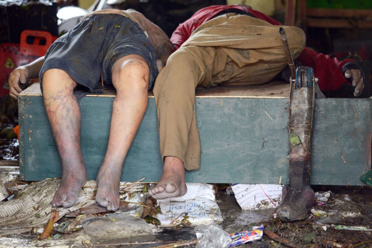 A prosthetic leg (right) is seen beside two dead bodies inside the Fisherman's Village Elementary School of Tacloban, eastern island of Leyte on November 10, 2013. The Pentagon said it was providing the Philippines with naval and aviation resources in the wake of a devastating typhoon. (Noel Celis/AFP/Getty Images)