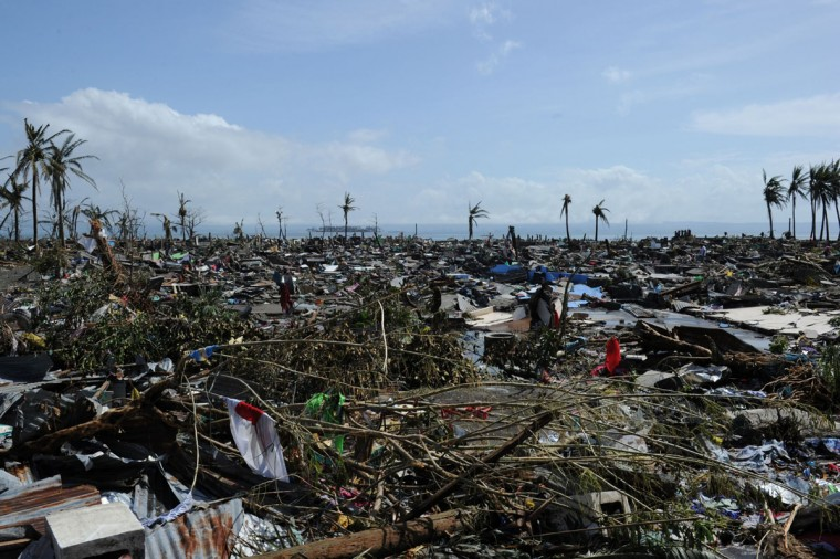 A general view of flattened houses along the coastal area in Tacloban, on the eastern island of Leyte on November 10, 2013 after Super Typhoon Haiyan swept over the Philippines. The typhoon that destroyed entire towns across the Philippines is believed to have killed more than 10,000 people, authorities said on November 10, which would make it the country's deadliest recorded natural disaster. (Ted Aljibe/AFP/Getty Images)