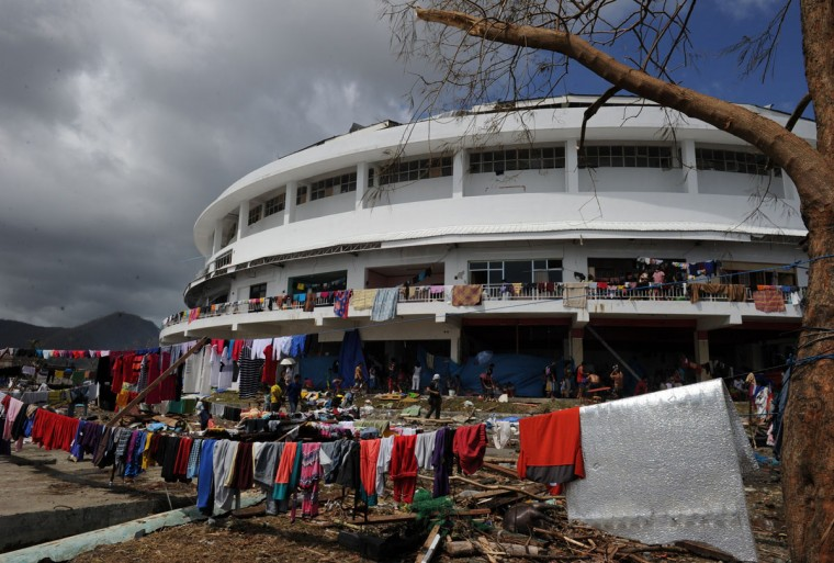 Clothes are put out to dry outside a stadium used as an evacuation centre in Tacloban, Leyte province, central Philippines on November 10, 2013, three days after devastating Typhoon Haiyan hit the city. The death toll from a super typhoon that decimated entire towns in the Philippines could soar well over 10,000, authorities warned on November 10, making it the country's worst recorded natural disaster. (Ted Aljibe/AFP/Getty Images)