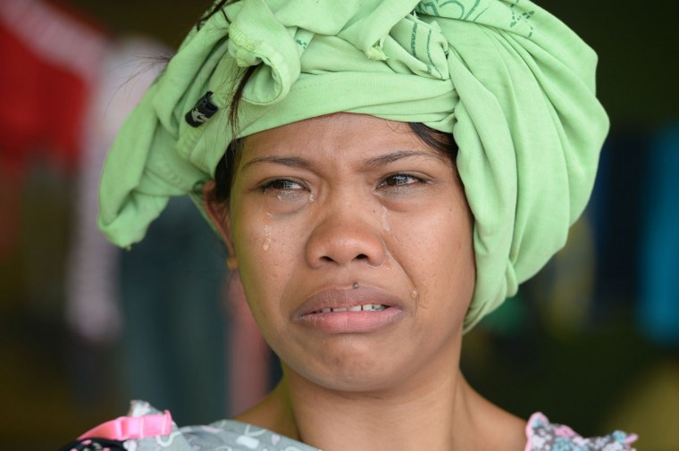 A resident cries as she relates her ordeal at the height of Typhoon Haiyan in Tacloban City, Leyte province, central Philippines on November 10, 2013. The death toll from a super typhoon that decimated entire towns in the Philippines could soar well over 10,000, authorities warned on November 10, making it the country's worst recorded natural disaster. (Ted Aljibe/AFP/Getty Images)