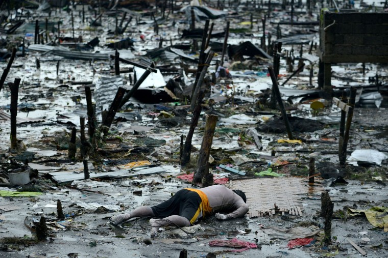 A body of a dead man is seen at the bay of Tacloban, eastern island of Leyte on November 10, 2013. A super typhoon that destroyed entire towns across the Philippines is believed to have killed more than 10,000 people, authorities said on November 10, which would make it the country's deadliest recorded natural disaster. (Noel Celis/AFP/Getty Images)