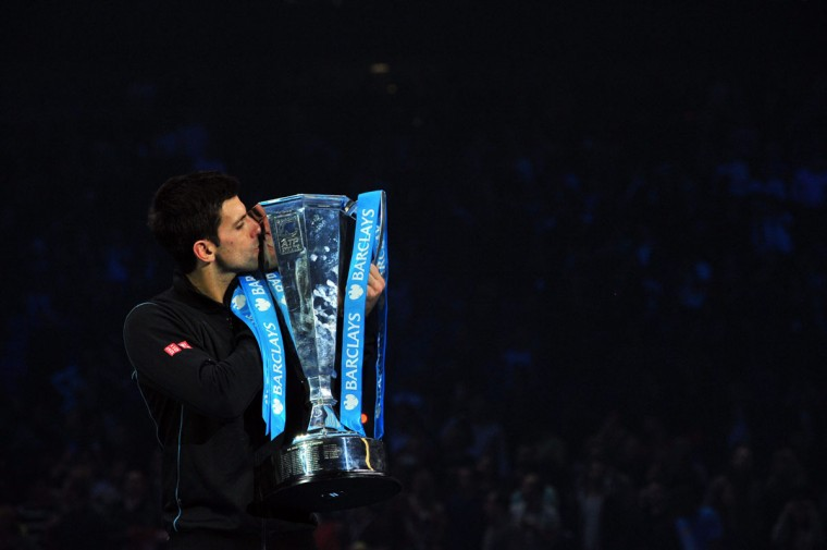 Serbia's Novak Djokovic kisses the Brad Drewett Trophy after beating Spain's Rafael Nadal in the singles final on the eighth day of the ATP World Tour Finals tennis tournament in London. (GLYN KIRK / AFP/Getty Images)