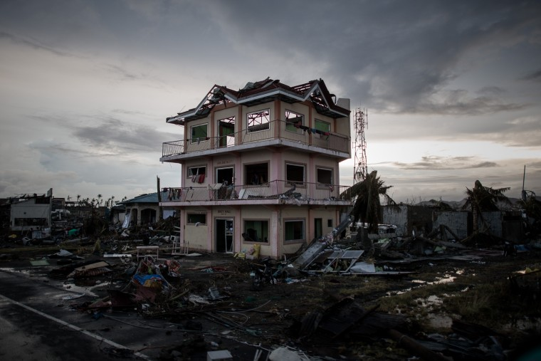 A the sun sets over a house damaged by Typhoon Haiyan outside the airport in Tacloban, on the eastern island of Leyte on November 12, 2013 after Super Typhoon Haiyan swept over the Philippines. The typhoon that destroyed entire towns across the Philippines is believed to have killed more than 10,000 people, which would make it the country's deadliest recorded natural disaster. (Philippe Lopez/AFP/Getty Images)