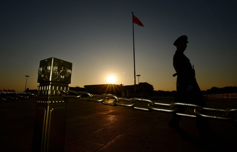 A Chinese para-military officer patrols Tiananmen Square in front of the Great Hall of the People (background) after the Communist Party Central Committee's concluded its secretive Third Plenum in Beijing. (MARK RALSTON / AFP/Getty Images)