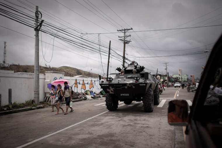 An armored vehicle patrols in a street of Tacloban, on the eastern island of Leyte on November 12, 2013 after Super Typhoon Haiyan swept over the Philippines. The UN launched an appeal for a third of a billion dollars on November 12 as US and British warships steamed towards the typhoon-ravaged Philippines where well over 10,000 people are feared dead. (Philippe Lopez/AFP/Getty Images