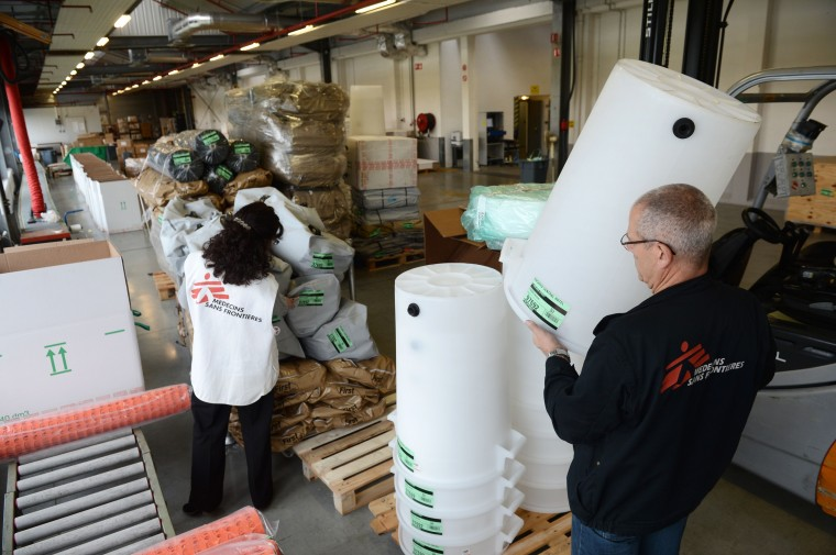 An employee of French humanitarian-aid NGO Doctors without Borders (MSF) prepares an emergency shipment as part of the reconstruction aid for Philippines aiming at helping victims of super typhoon Haiyan on November 12, 2013 at the NGO's logistic centre in Merignac, southwestern France. (Mehdi Fedouach/AFP/Getty Images)