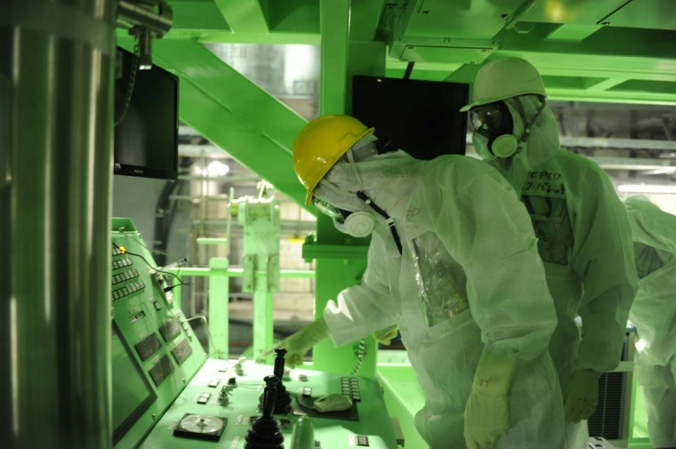 This handout picture taken by Tokyo Electric Power Co (TEPCO) on November 13, 2013 shows US nuclear expert Lake Barrett (R) inspecting the unit four reactor building of the crippled TEPCO's Fukushima Dai-ichi nuclear plant at Okuma town in Fukushima prefecture. Barrett was in Fukushima for the preparation of removal of fuels from spent fuel pool in the unit four reactor building.