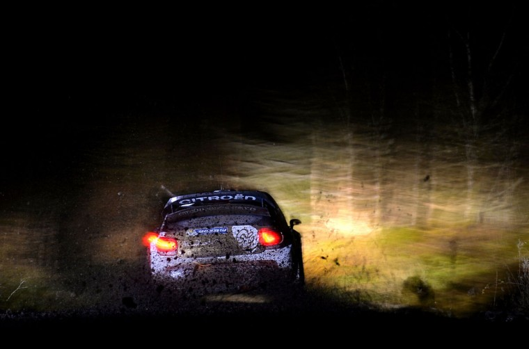 Spain's Dani Sordo and co-driver Carlos Del Barrio drive their Citroen Total Abu Dhabi WRT DS3 during the Gwydyr night stage on day one of the FIA World Rally Championship Great Britain in Gwydyr on November 14, 2013. (Ben Stansall/AFP/Getty Images)