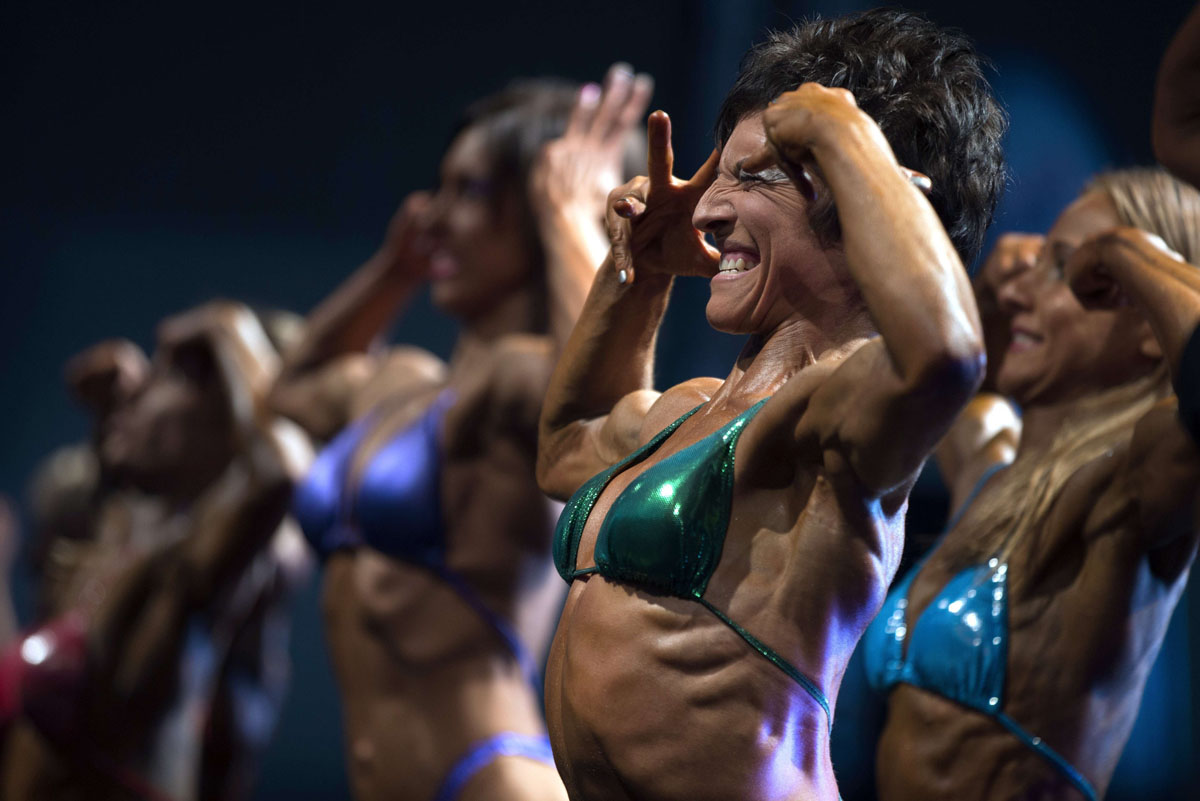Competitors take part on November 16, 2013 in the Natural Body Building International Union (UIBBN) world championships in Paris. (Joel Saget/AFP/Getty Images)