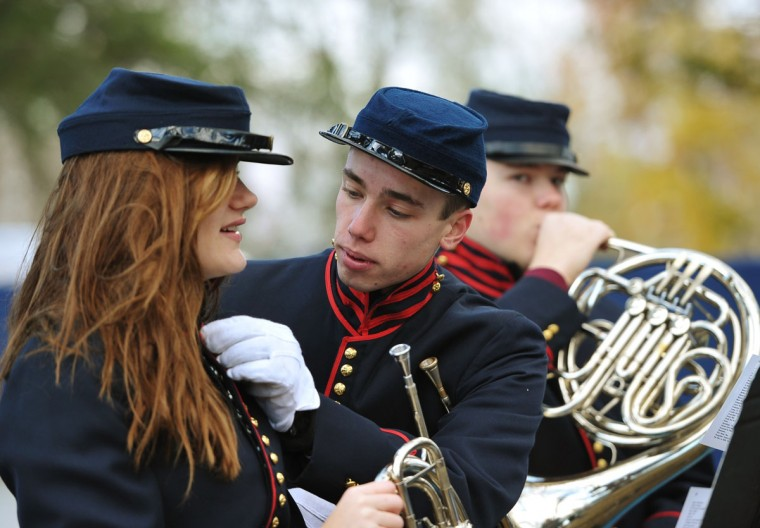 A member of the Gettysburg High School Ceremonial Brass Band helps a fellow band member with her uniform before the start of the commemoration ceremony on the 150th anniversary of US President Abraham Lincolns historic Gettysburg Address on November 19, 2013 at Gettysburg National Military Park in Gettysburg, Pennsylvania.(Mandel Ngan/AFP/Getty Images)
