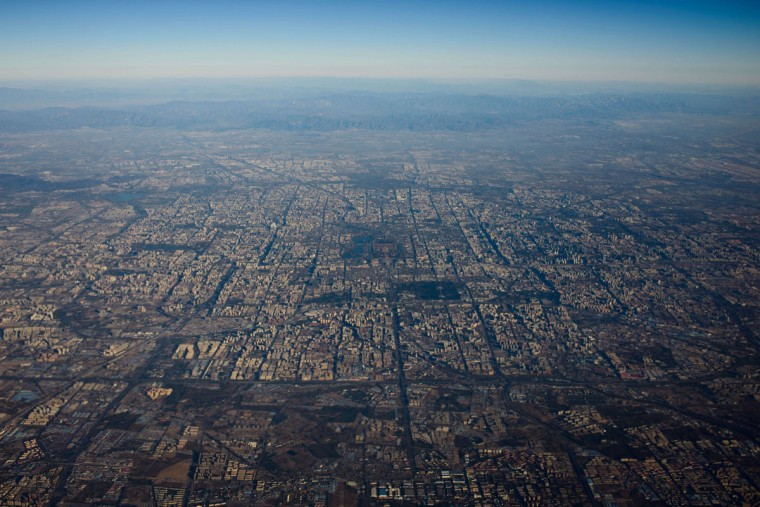 A photo taken on November 7, 2013 shows an aerial view of Beijing from the window of an aircraft. The view, facing north, shows Tiananmen Square and the Forbidden City (C), the Olympic Park (top C), the Temple of Heaven (mid center R), Beihai and Houhai lakes (center L), and the Beijing South high-speed Railway Station (mid center L). (Ed Jones/AFP/Getty Images)
