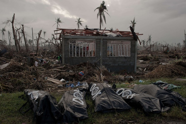 The bodies of five victims of typhoon Haiyan found by a Zion Emergency and Disaster Rescue Unit lie in front of a damaged house in Tanauan on November 20, 2013. The United Nations has confirmed at least 4,500 killed by typhoon Haiyan, which brought five-metre (16-foot) waves to Tacloban, flattening nearly everything in their path as they swept hundreds of metres across the low-lying land. (nicolas Asfourani/AFP/Getty Images)