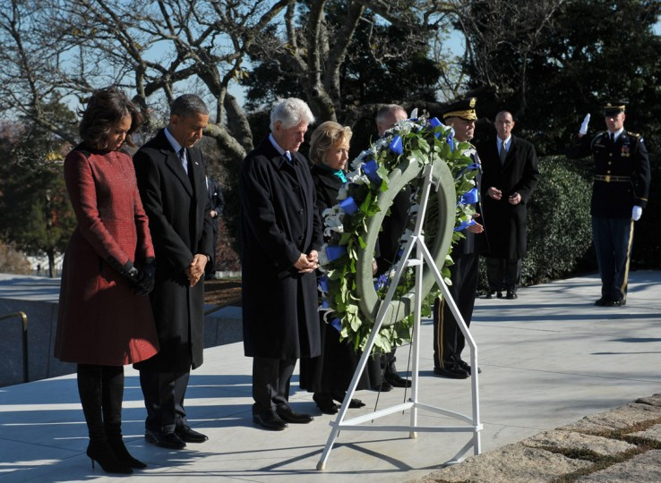 US President Barack Obama(2nd-L), First Lady Michelle Obama(L) along with former president Bill Clinton(3rd-L) and former secretary of state Hillary Clinton(4th-L) take part in a wreath-laying ceremony in honour of the late 35th president of the US John F. Kennedy at Kennedy's gravesite in Arlington National Cemetery on November 20, 2013 in Arlington, Virginia. (Mandel Ngan/AFP/Getty Images)