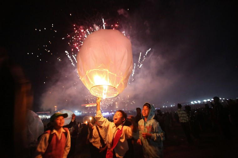 In Taunggyi, Myanmar's northeastern Shan State, participants celebrate after releasing a hot-air balloon during the Tazaungdaing Lighting Festival. Every year in November as the full moon approaches, tens of thousands of people from all over the country gather in Taunggyi for the colorful hot-air balloons festival. (Ye Aung Thu / AFP/Getty Images)