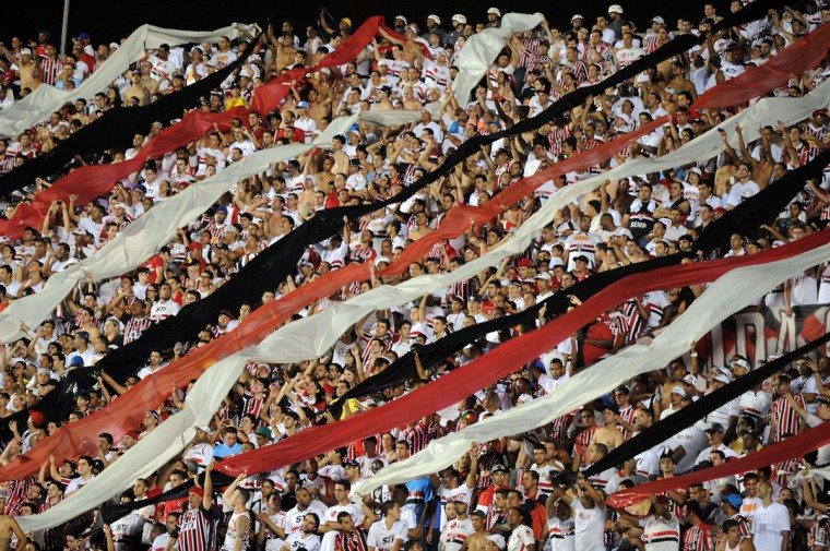 Supporters of Brazilian Sao Paulo cheer their team during the 2013 Copa Sudamericana football match against Brazil's Ponte Preta at Morumbi Stadium in Sao Paulo, Brazil. (NELSON ALMEIDA / AFP/Getty Images)