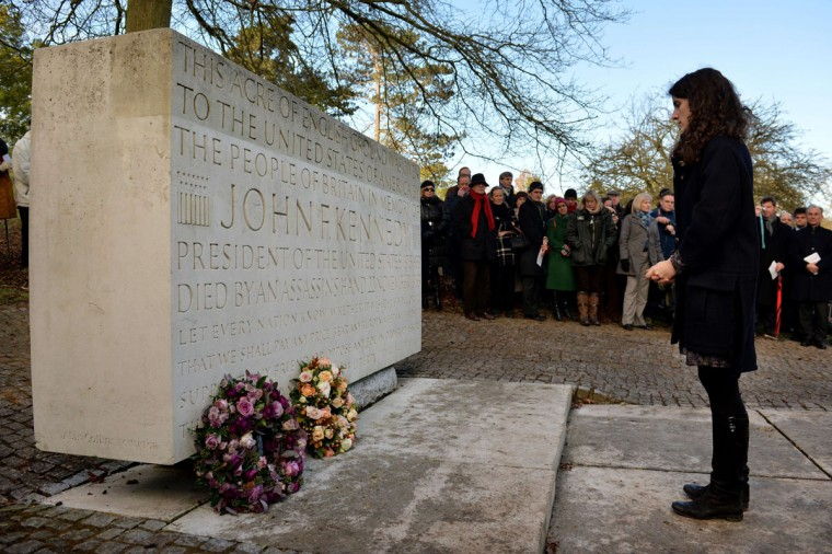 Tatiana Schlossberg, granddaughter of former US President John F Kennedy lays a wreath during a memorial service in Runnymede, Surrey on November 22, 2013, to mark the 50th anniversary of his assassination. (Ben Stansall/AFP/Getty Images)