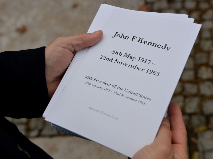 An attendee holds an order of service at a memorial for former US President John F Kennedy in Runnymede, Surrey on November 22, 2013, to mark the 50th anniversary of his assassination. (Ben Stansall/AFP/Getty Images)