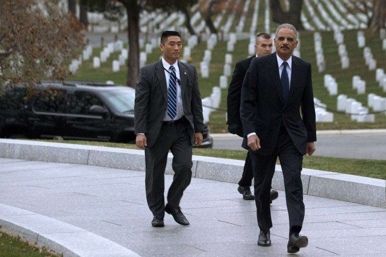 Attorney General Eric Holder(R), arrives to pay his respects at the grave of John F. Kennedy at Arlington National Cemetery on November 22, 2013, on the 50th anniversary of Kennedy's death. Holder has been visiting the grave since his youth, and would visit there with his mother before she passed away. (Jacquelyn Martin/AFP/GEtty Images