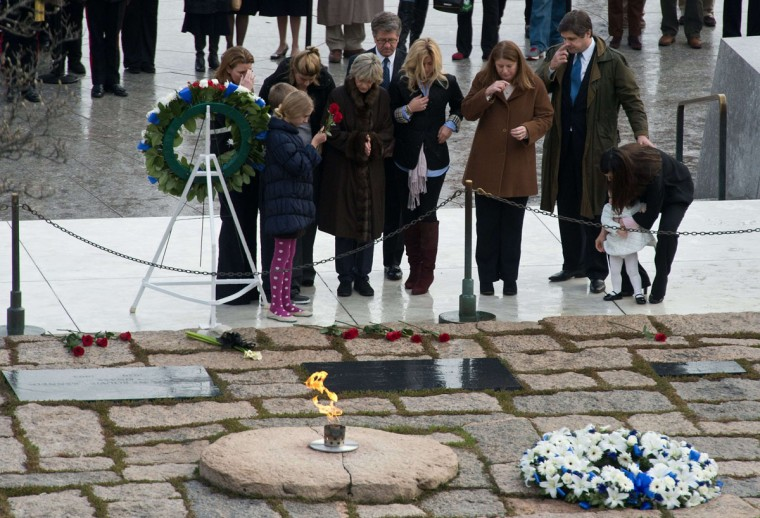 Members of the Kennedy family gather at the gravesite of former US President John F. Kennedy during a ceremony at Arlington National Cemetery in Arlington, Virginia, on November 22, 2013, the 50th anniversary of his assassination. (Nicholas Kammni/AFP/Getty Images)