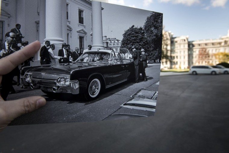 A historic photo dated June 15, 1961 (Robert Knudsen, White House Photographs, John F. Kennedy Presidential Library and Museum, Boston) is displayed in the driveway near the White House in Washington, DC November 8, 2013. The archive photo shows former US President John F. Kennedy's X-100 limousine during a demonstration. The X-100 limo, based on the 1961 Lincoln Continental 4-door convertible, featured interchangeable tops and a hydraulic seat to elevate the president. When President Kennedy was assassinated November 22, 1963 he was riding in the limo without its top while passing though Dealey Plaza in Dallas, Texas. November 22, 2013 marks the 50th anniversary of President John F. Kennedy's assassination.
