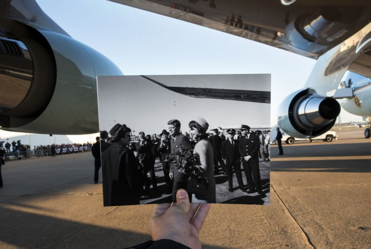 A historic photo dated November 22, 1963 showing former US President John F. Kennedy and First Lady Jacqueline Kennedy arriving in Dallas, Texas (Cecil Stoughton, White House Photographs, John F. Kennedy Presidential Library and Museum, Boston) is held up by the photographer against Air Force One in the background as US President Barack Obama arrives at Love Field November 6, 2013 in Dallas, Texas. The archive photo depicts the Kennedy's after they got off an Air Force One based on the Boeing 707 while the modern 747-style Air Force One's wing and engines can be seen in the current photograph. November 22, 2013 marks the 50th anniversary of President John F. Kennedy's assassination in Dallas, Texas.