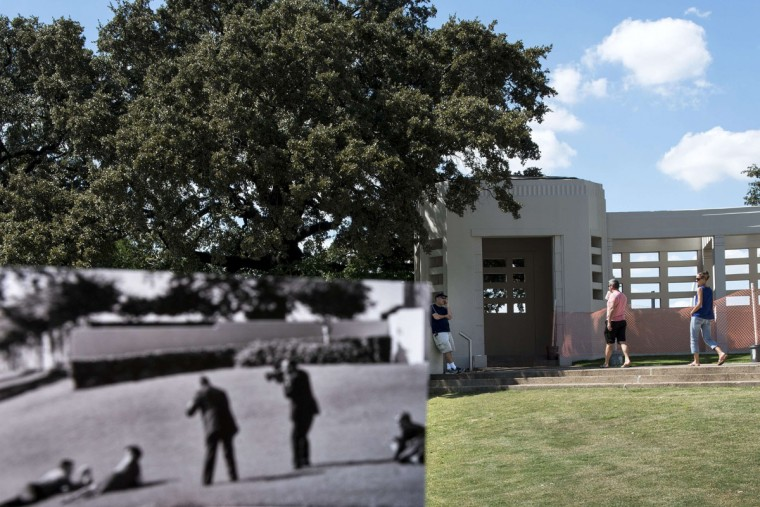 A historic photo dated November 22, 1963 (Cecil Stoughton, White House Photographs, John F. Kennedy Presidential Library and Museum, Boston) is held up by the photographer and juxtaposed with the original scene October 10, 2013 in Dallas, Texas. The White House photo depicts the Newman family on the ground after former US President John F. Kennedy was shot in Dallas's Dealey Plazza, Texas. November 22, 2013 marks the 50th anniversary of President John F. Kennedy's assassination.