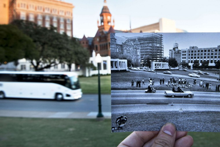 A historic photo of post JFK assassination Dealey Plazza (Dallas Police Department, Dallas Municipal Archives, City of Dallas, Texas) is displayed near its original location in Dallas, Texas October 7, 2013. The archive photo depicts investigators reconstructing the assassination of former US President John F. Kennedy near where he received a fatal rifle shot to the head. November 22, 2013 marks the 50th anniversary of President John F. Kennedy's assassination.
