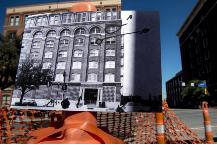 A historic photo of post JFK assassination shows the Texas School Book Depository building (Dallas Police Department, Dallas Municipal Archives, City of Dallas, Texas) displayed near its original location in modern day Dealey Plazza in Dallas, Texas October 8, 2013. The archive photo was used in testimony before the Warren Commission and has been marked to show where a witness saw a man with a rifle and onlookers. November 22, 2013 marks the 50th anniversary of President John F. Kennedy's assassination.
