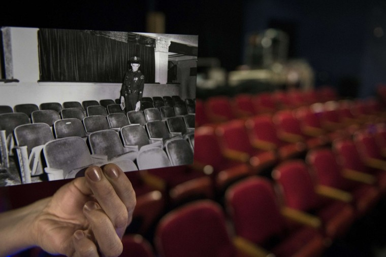 A 1963 historic photo showing a Dallas police officer inside the Texas Theater (Dallas Police Department, Dallas Municipal Archives, City of Dallas, Texas) is seen inside the original location in Dallas, Texas October 8, 2013. The archive photo shows the officer pointing to one seat where Lee Harvey Oswald, the alleged assassin of former US President John F. Kennedy, was spotted sitting. November 22, 2013 marks the 50th anniversary of President John F. Kennedy's assassination.