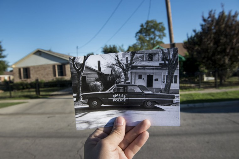 A 1963 historic photo showing Dallas Police Officer J. D. Tippit's car (Dallas Police Department, Dallas Municipal Archives, City of Dallas, Texas) is seen October 8, 2013 near where it was originally taken on East 10th Street in Dallas, Texas. Officer Tippit was shot by Lee Harvey Oswald, the alleged assassin of former US President John F. Kennedy. November 22, 2013 marks the 50th anniversary of President John F. Kennedy's assassination.