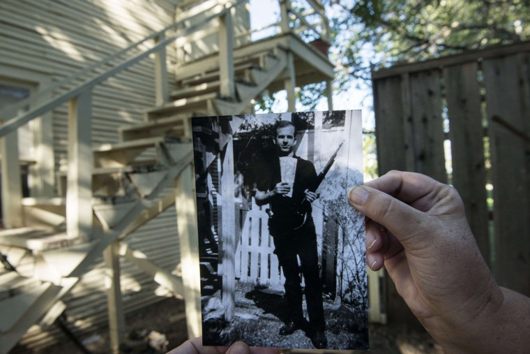 An undated historic photo shows Lee Harvey Oswald (Dallas Police Department, Dallas Municipal Archives, City of Dallas, Texas) in its approximate modern day location behind a home on West Neely Street in Dallas, Texas October 9, 2013. The photo, which once appeared on the cover of Life, allegedly taken by Marina Oswald, and depicting the alleged assassin of former President john F. Kennedy with a rifle and communist newspapers, has been a point of controversy many claiming it was a fake. November 22, 2013 marks the 50th anniversary of President John F. Kennedy's assassination.