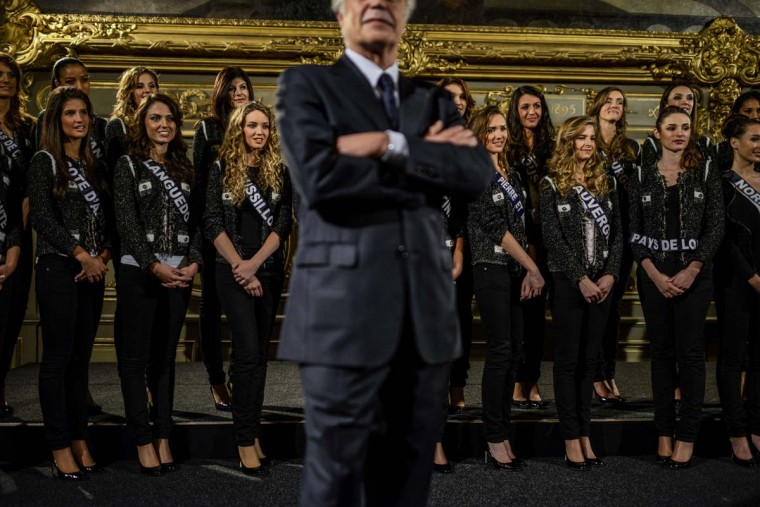 Dijon's mayor and senator Francois Rebsamen stands in front of Miss France 2014 contestants on November 23, 2013 at the city hall in Dijon. The beauty contest will take place on December 7, 2013. JEFF PACHOUD/AFP/Getty Images