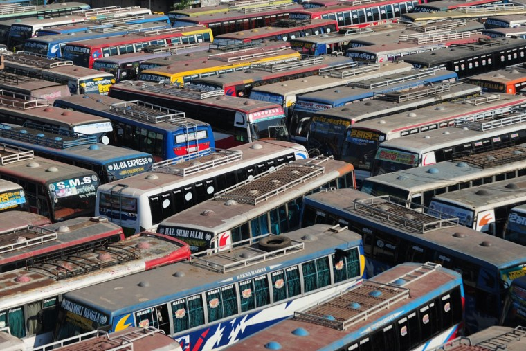 Buses are parked at an inter-district bus terminal during a blockade organised by Bangladesh Nationalist Party (BNP) activists and its Islamist allies in Dhaka on November 26, 2013. Bangladesh opposition supporters went on the rampage, blocking roads and ripping up railway tracks after rejecting plans for a January 5 election, plunging the nation into fresh political turmoil. (Munir uz Zaman/AFP/Getty Images)