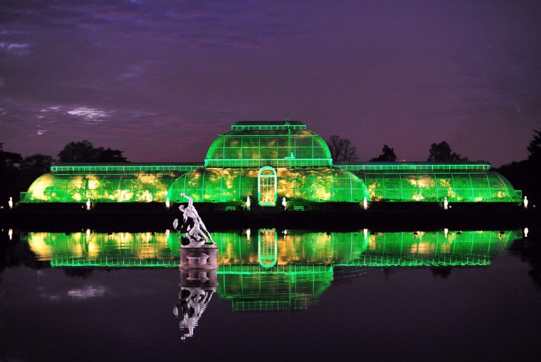 The Palm House at Kew Royal Botanical Gardens is lit green during a preview for the Christmas at Kew event at Kew Gardens in south west London on November 27, 2013. (CARL COURT/AFP/Getty Images)