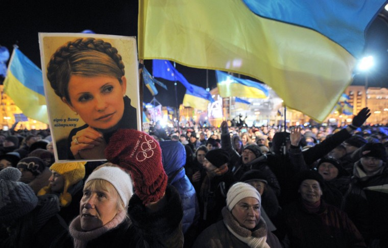 A woman holds a portrait of jailed former Prime Minister Yulia Tymoshenko during a rally of the pro-European movement in central Kiev, on November 27, 2013, on the fourth day of protests over the government's decision to scrap a key pact with the EU. (GENYA SAVILOV/AFP/Getty Images)
