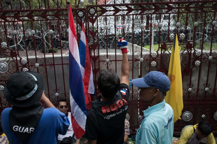 Anti-government protesters shout slogans in front the national police headquarters during a demonstration in Bangkok on November 28, 2013. (NICOLAS ASFOURI/AFP/Getty Images)