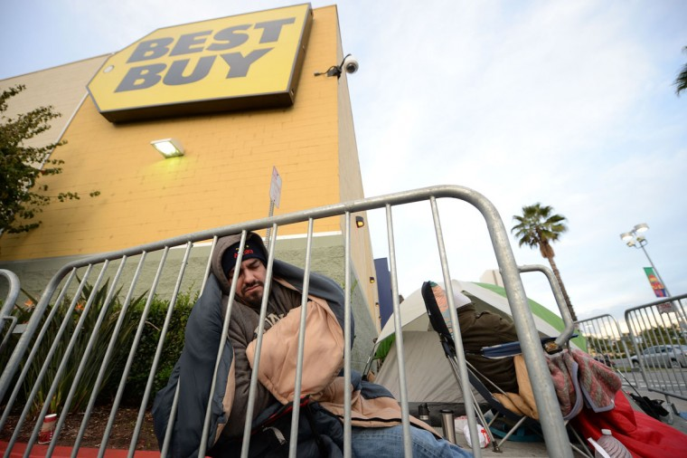 A man sleeps in a chair as he waits in line for the doors to open on Thanksgiving Day at the Best Buy store in Burbank, California November 28, 2013. More than a dozen US retailers will open their doors to shoppers one day ahead of the famed-Black Friday shopping day. (Robyn Beck/AFP/Getty Images)