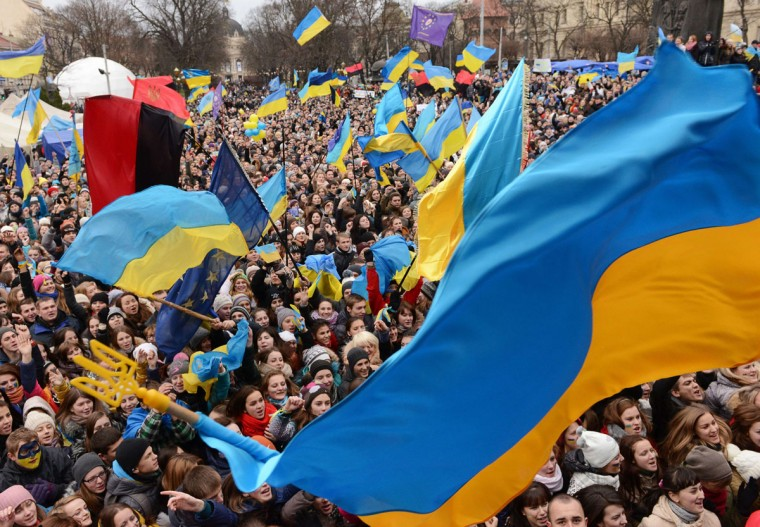 Pro-European protesters wave Ukrainian flags during a rally in the western Ukrainian city of Lviv on November 28, 2013. (YURIY DYACHYSHYN/AFP/Getty Images)