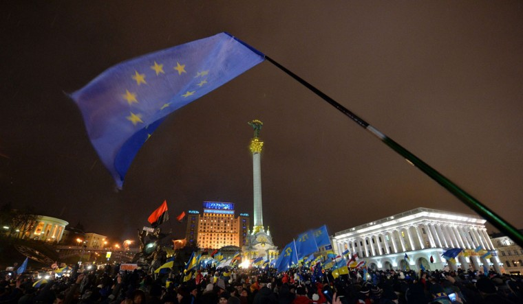 An EU flag waves on Independence Square in Kiev during a mass rally in Kiev on November 28, 2013. (SERGEI SUPINSKY/AFP/Getty Images)