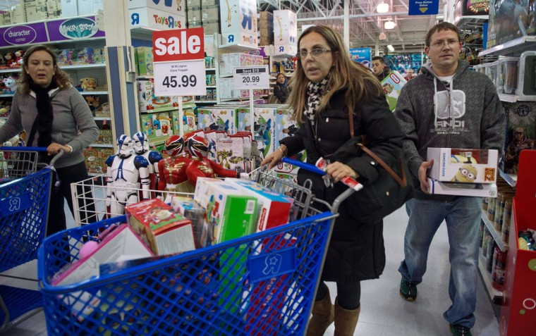 Shoppers wait in line during the Thanksgiving holiday on November 28, 2013, at the Toys-R-Us store in Fairfax, Virginia. More than a dozen US retailers opened their doors to shoppers one day ahead of the famed-Black Friday shopping day. (Paul J. Richards/AFP/Getty Images)