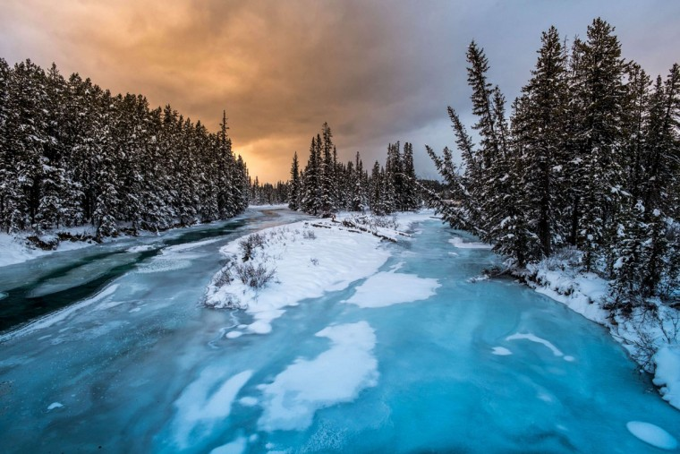 Partially frozen Bow River makes its way through the Alberta's Banff National Park in Lake Louise, the host of men's alpine skiing FIS World Cup, in Lake Louise, Canada, on November 28, 2013. Today's downhill was cancelled due to the power failure.(Joe Klamar/AFP/Getty Images)